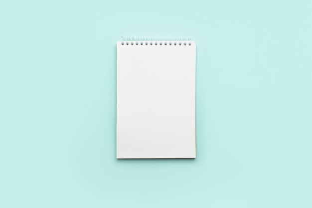 Notepad on a pastel turquoise.