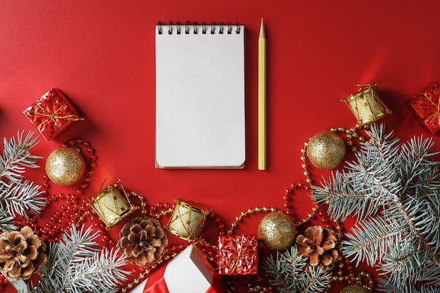Notepad and pencil for writing wishes and gifts for the new year and christmas around the christmas