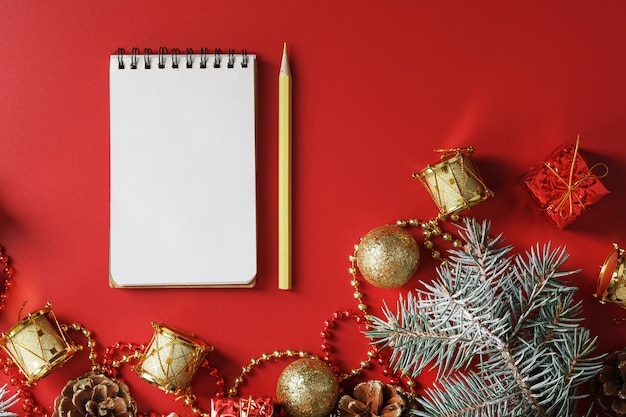 Notepad and pencil for writing wishes and gifts for the new year