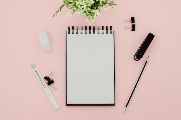 Notepad  on pink background with copy space.