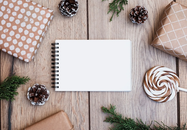 Notepad between presents in wraps, lollipop and snags