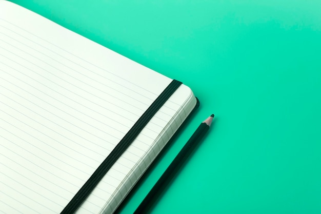 Notepad for sticky notes on the desktop. office desktop, management and timing concept.