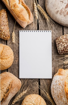 Notepad surrounded by wheat and bread