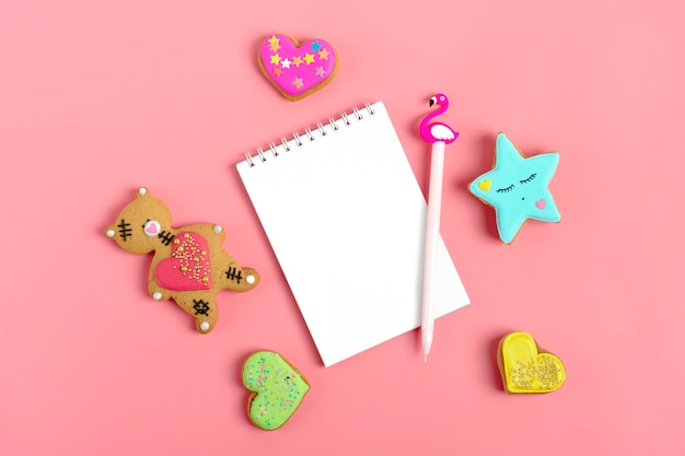 Notepad on trendy pink background