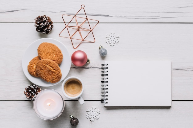 Notepad with cookies on table