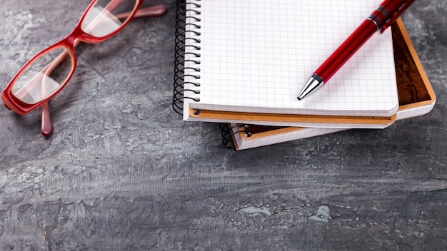 Notepad with pen, glasses business concept