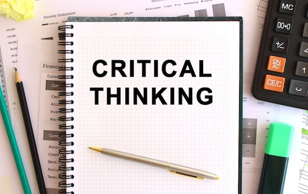 Notepad with text critical thinking on a white surface. business concept.