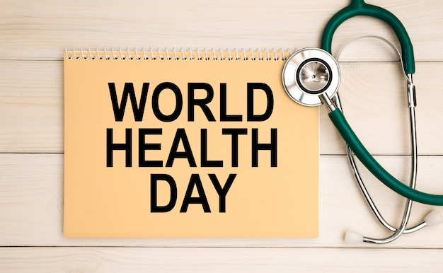 Notepad with text world health day and stethoscope. medical concept.