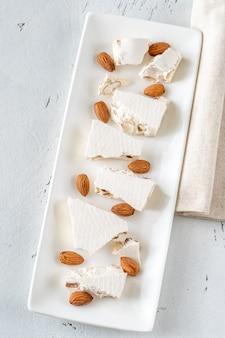 Nougat with nuts on a white plate