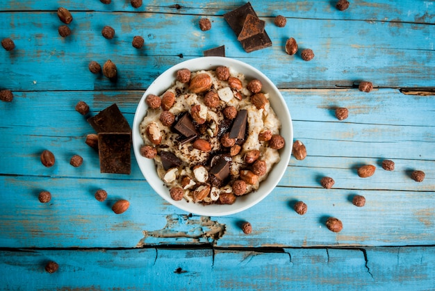 Nourishing and delicious breakfast, oatmeal with hazelnuts