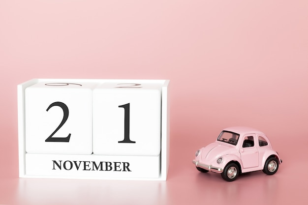 November 21st. day 21 of month. calendar cube with car