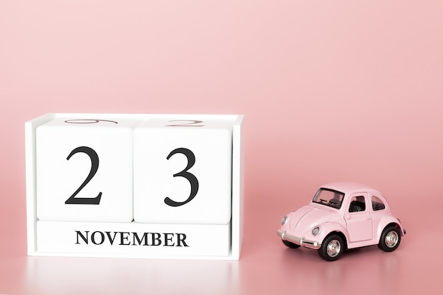 November 23rd. day 23 of month. calendar cube with car