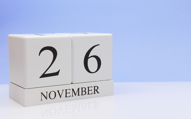November 26st. day 26 of month, daily calendar on white table with reflection