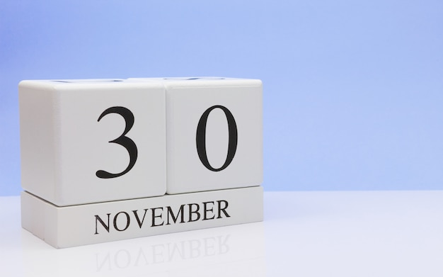 November 30st. day 30 of month, daily calendar on white table with reflection