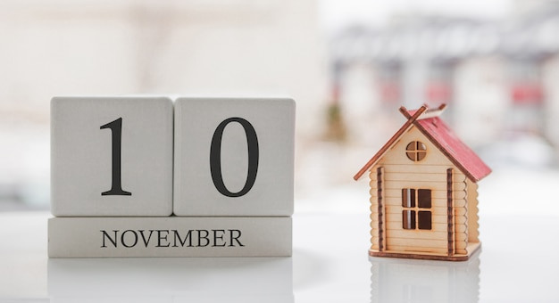 November calendar and toy home. day 10 of month. card message for print or remember