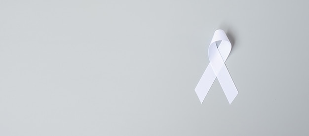November lung cancer awareness month, democracy and international peace day. white ribbon on grey background