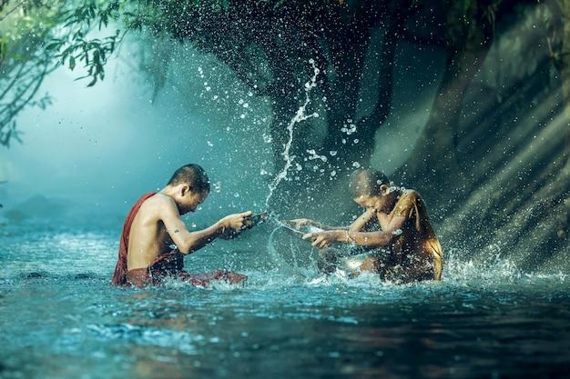 Novice buddhist monk splashing.