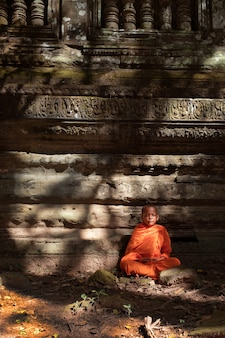 Novices are meditating in ancient sites.