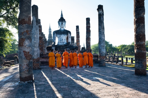 The novices are worshiping an ancient buddha image