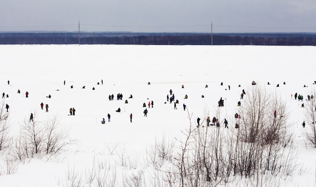 Novocheboksarsk,russia-february 27, 2021:rybak rybak festival, fishing on the frozen river.