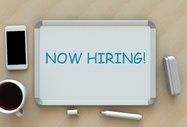 Now hiring !, message on whiteboard, smart phone and coffee on table
