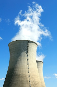 Nuclear power plant infrastructure in a blue sky