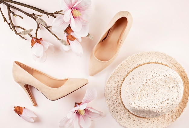 Nude colored high heels shoes and magnolia flowers
