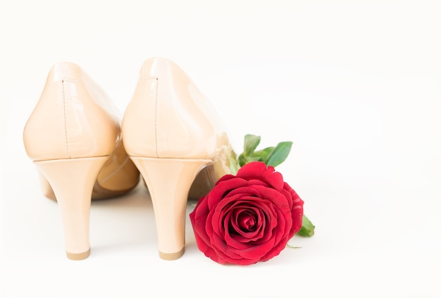 Nude colored high heels still life with red rose