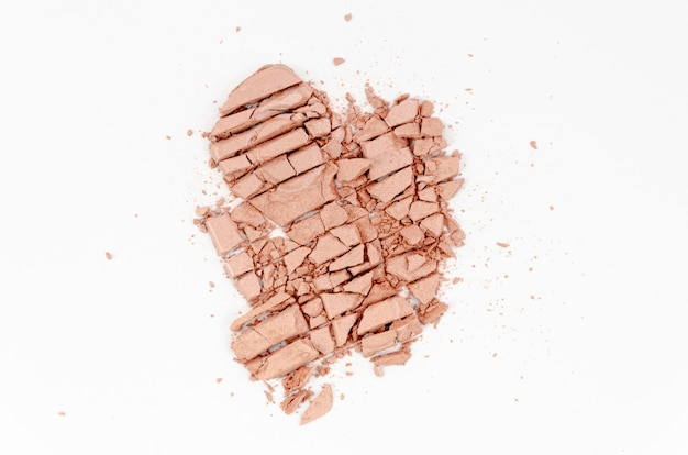 Nude powder on white background
