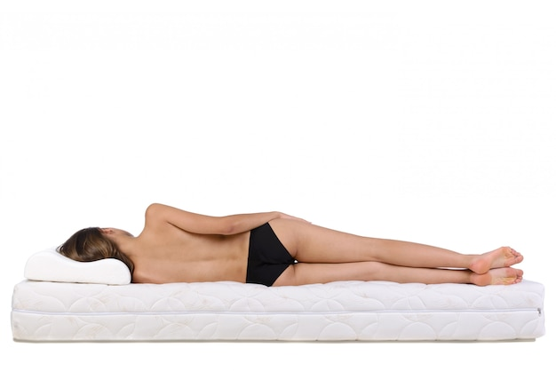 Nude woman lying on a mattress.
