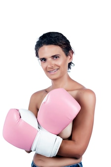 Nude young woman with pink boxing gloves, depicting a fight against breast cancer awareness.