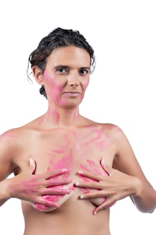 Nude young woman with pink hands, depicting fight against breast cancer awareness.
