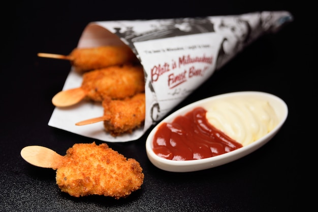 Nuggets on a stick in a paper bag