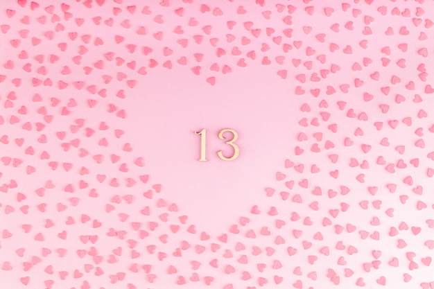 Number 13 thirteen made of wood in heart shaped decoration with small hearts