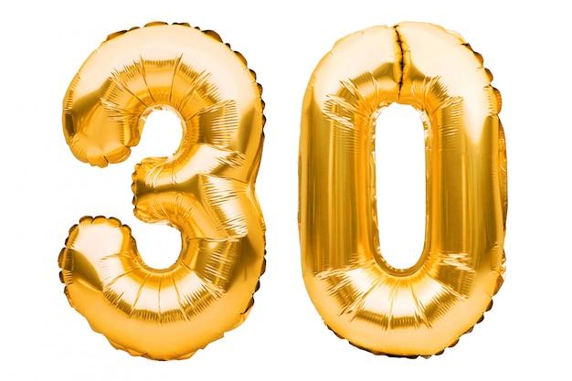 数30 30は白で隔離される黄金の膨脹可能な風船で作られました。ヘリウム風船、金箔の番号。
