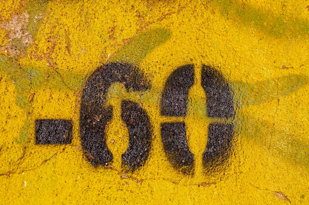 Number 60 on a stone old wall