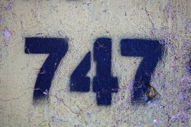 Number 747 on a stone old wall