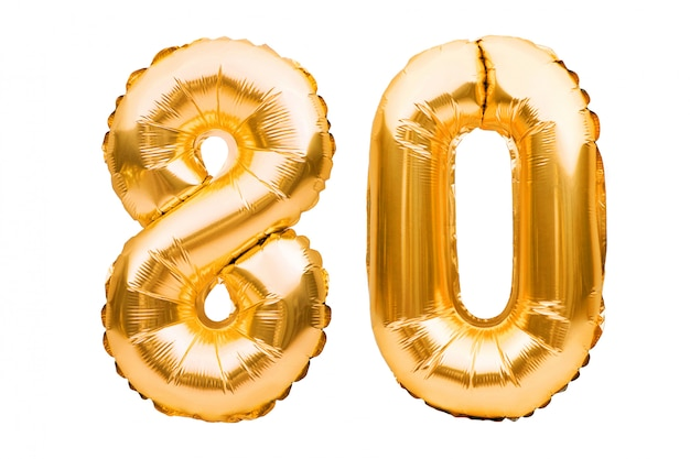 Number 80 eighty made of golden inflatable balloons isolated on white. helium balloons, gold foil numbers.