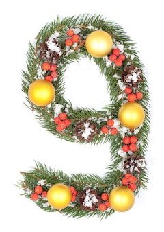 Number 9 made of christmas fir branch and decorations