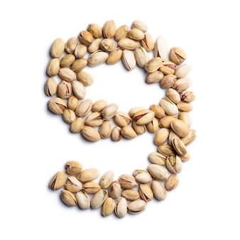 Number 9 made from unpeeled pistachios