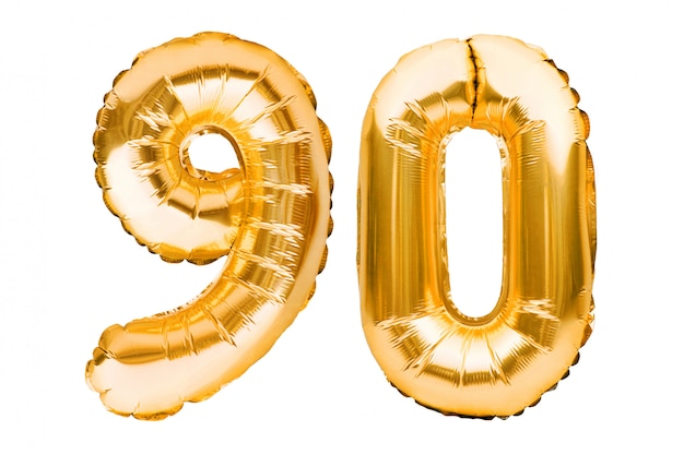 Number 90 ninety made of golden inflatable balloons isolated on white. helium balloons, gold foil numbers.