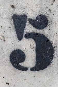 Number five painted stencil on concrete wall, number five, number 5