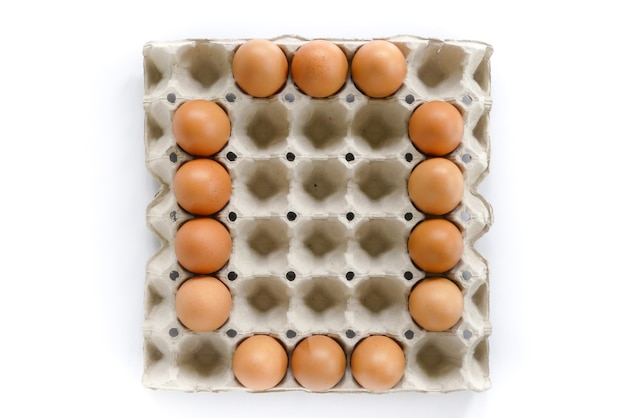Number letters arrange from eggs in paper tray on white background.