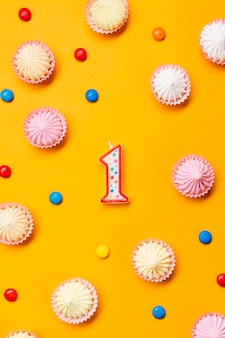 Number one candle surrounded with aalaw and gems on yellow background