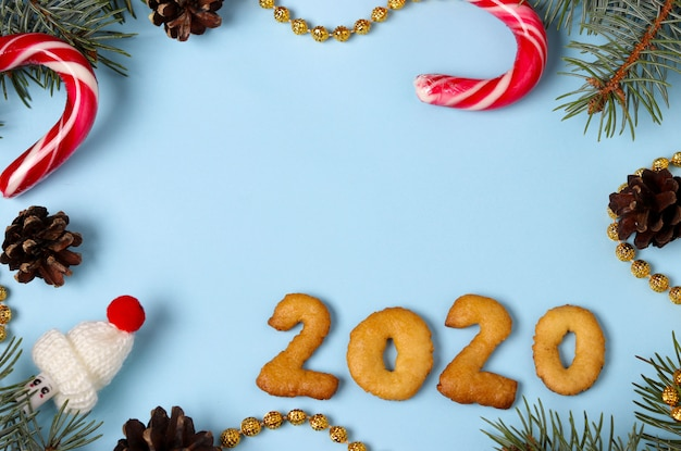 Numbers 2020 merry christmas from gingerbread cookies top view, blue background