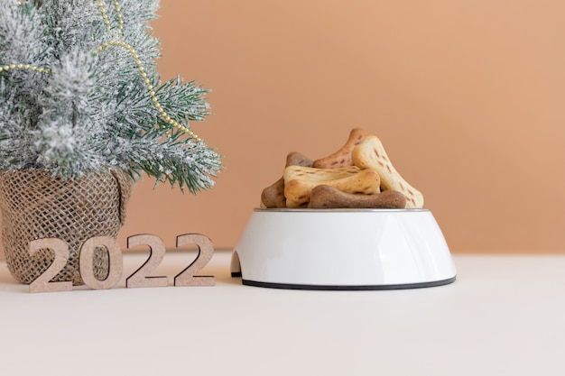 Numbers 2022 as a symbol of the upcoming new year a full bowl of dog food
