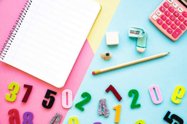 Numbers near stationery and calculator