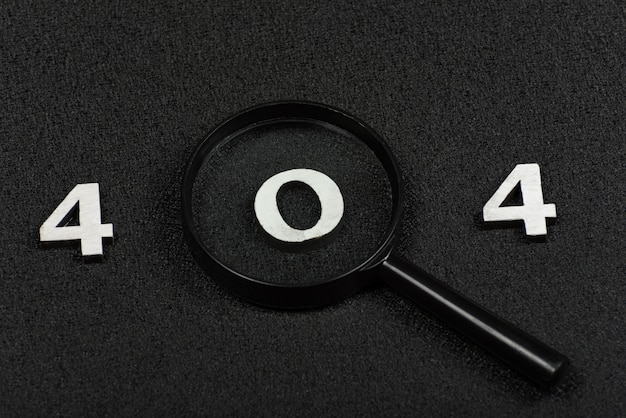 Numerals 404 and magnifying glass on black background