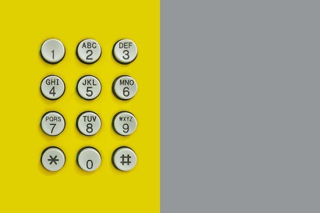 Numeric keypad of phone on yellow