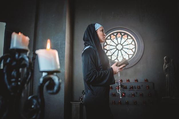 Nun praying in a monastery